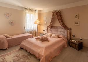 Letto o letti in una camera di Appartamento Biancospino