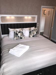 A bed or beds in a room at Design Suites Lytham