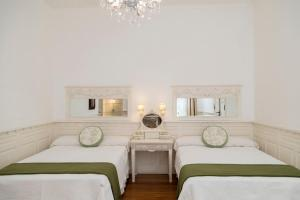A bed or beds in a room at Villa Vicuña Hotel Boutique