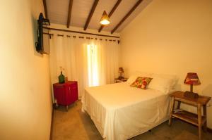 Cama ou camas em um quarto em Hostel e Pousada Casa de Paixão Caraíva