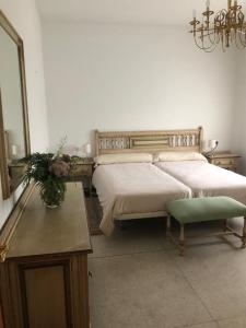 Cama o camas de una habitación en Impresionante casa con piscina y vistas únicas