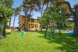 Children's play area at Zarkadis Beach Apartments