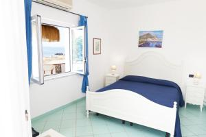 A bed or beds in a room at O'Vagnitiello
