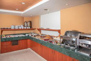 A kitchen or kitchenette at Madisson Hotel