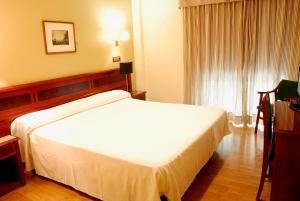 Cama o camas de una habitación en Reyes Católicos
