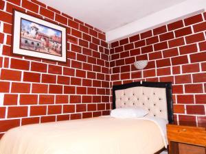 Cama o camas de una habitación en Hotel Encanto Machu Picchu