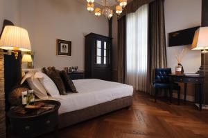 Кровать или кровати в номере Palazzo Roselli Cecconi