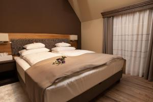 A bed or beds in a room at Panorama Boutique Hotel