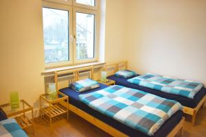 A bed or beds in a room at Ferienhaus-Duisburg-Landschaftspark