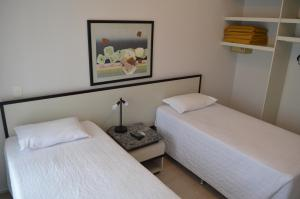 A bed or beds in a room at Bristol Metropolitan Flat