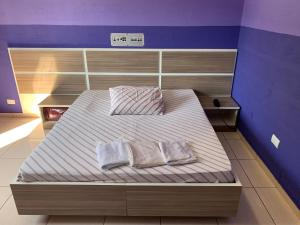 A bed or beds in a room at Hotel Orquídea -Rudge Ramos (Adults only)