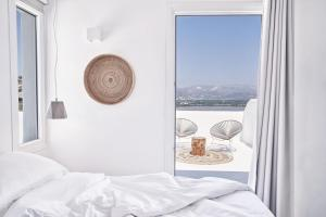 A bed or beds in a room at Naxian Utopia   Luxury Villas & Suites
