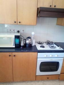 A kitchen or kitchenette at Kampi Double Storey House in the Village