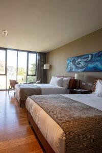 A bed or beds in a room at Ladera Boutique Hotel