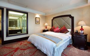 A bed or beds in a room at Royal Mediterranean Hotel