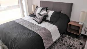 A bed or beds in a room at Minimalistic and modern decore 1B apartment Polanco