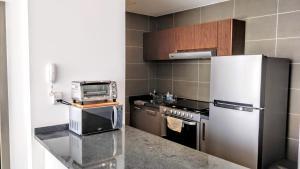 A kitchen or kitchenette at Minimalistic and modern decore 1B apartment Polanco