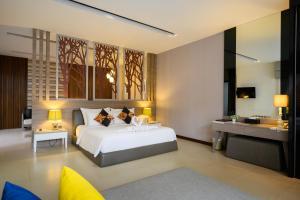 A bed or beds in a room at Cae Villa Hua Hin
