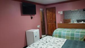 Cama o camas de una habitación en Hotel Opção