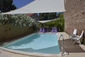 The swimming pool at or near L'Armateur
