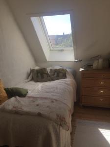 En eller flere senge i et værelse på Jette's værelsesudlejning