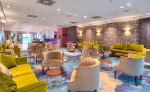 The lounge or bar area at Michel Hotel Frankfurt Maintal