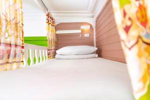 A bed or beds in a room at Hostel na Nevskom Mishanya