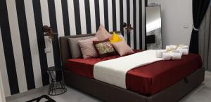 A bed or beds in a room at prestige house
