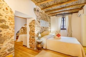 A bed or beds in a room at Albergo Diffuso Mannois