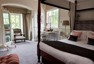 A bed or beds in a room at Careys Manor Hotel & Spa
