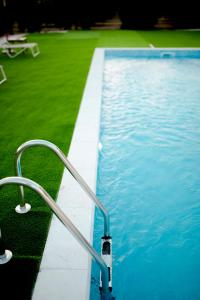 The swimming pool at or near Frunze Luxury Apartments