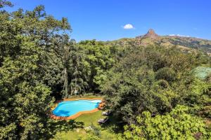 A view of the pool at Mantenga Lodge or nearby