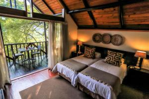 A bed or beds in a room at Mantenga Lodge