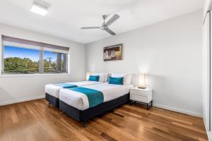 Ein Bett oder Betten in einem Zimmer der Unterkunft Essence Apartments Chermside