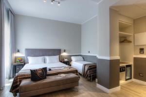 A bed or beds in a room at Fragrance Hotel St. Peter