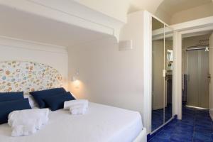 Un ou plusieurs lits dans un hébergement de l'établissement Dimore De Luca- Sea View