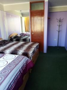 Cama o camas de una habitación en Buenaventura Perú Guest House