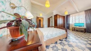 Кровать или кровати в номере Отель Резиденция Утриш