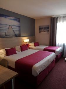 Un ou plusieurs lits dans un hébergement de l'établissement Atoll Hotel restaurant