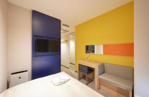 A television and/or entertainment centre at Sotetsu Grand Fresa Osaka-Namba
