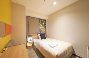 A bed or beds in a room at Sotetsu Grand Fresa Osaka-Namba