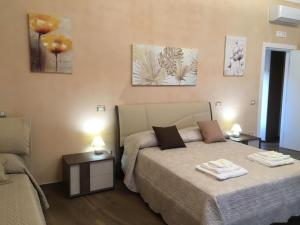 A bed or beds in a room at La terrazza sul Duomo B&B