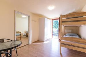 A bunk bed or bunk beds in a room at Dolar Rooms