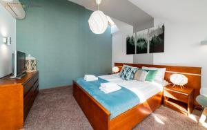 Łóżko lub łóżka w pokoju w obiekcie Apartamenty Wonder Home - przy Zacisznej