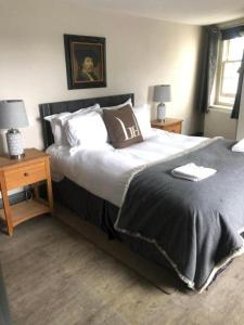 A bed or beds in a room at Linden House Stansted
