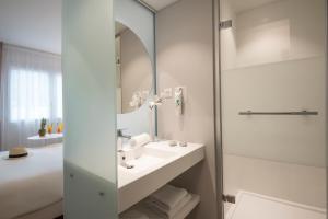 A bathroom at ibis Styles Nice Cap 3000
