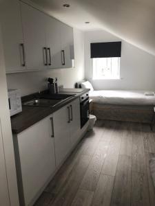 A kitchen or kitchenette at Polygon Villas