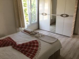 Ein Bett oder Betten in einem Zimmer der Unterkunft Doc's Wellness & Spa Hotel