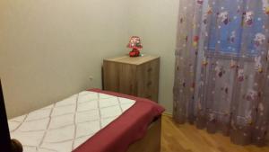 Cama ou camas em um quarto em Baku white city big apartmant