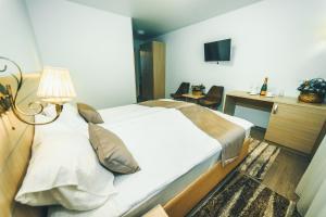 Кровать или кровати в номере Hotel Berezka